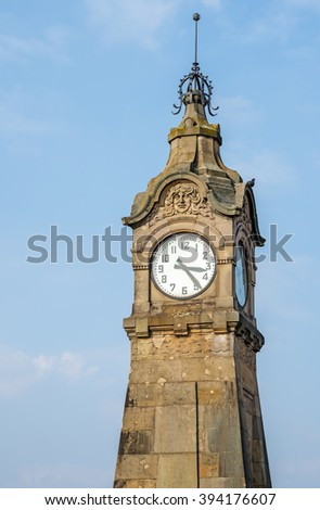 """Close view of the historic clock """"Pegeluhr"""" in Dusseldorf in Germany - stock photo"""