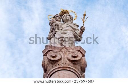 Close view of the sculpture of Maria with Jesus in Murnau near Munich in Bavaria - stock photo