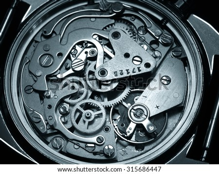 close view of vintage watch mechanism  monochrome image - stock photo