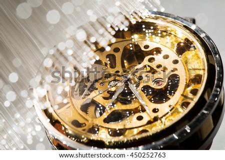 close view of watch mechanism and Fiber optics background - stock photo