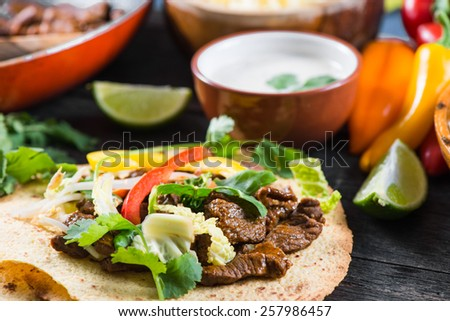 close view on mexican tacos with beef and vegetables - stock photo