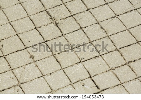 Close wet concrete slab texture in construction site - stock photo