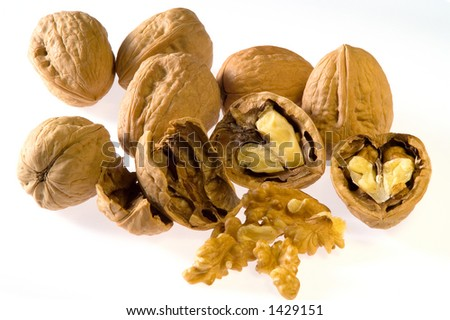 Closed and opened walnuts - stock photo