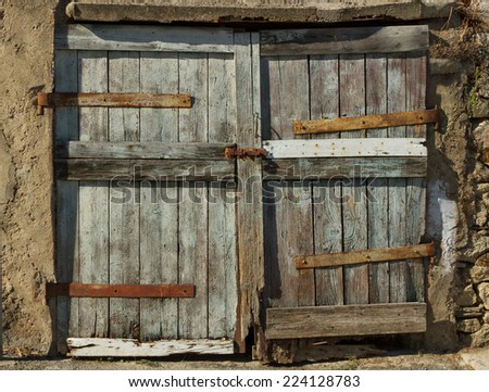 Closed big old door with rusty key. - stock photo