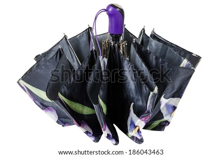 Closed black umbrella with flowers isolated on white background - stock photo