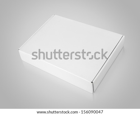 Closed blank carton box on gray background with clipping path - stock photo