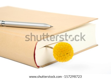 closed book and pen for writing  - stock photo