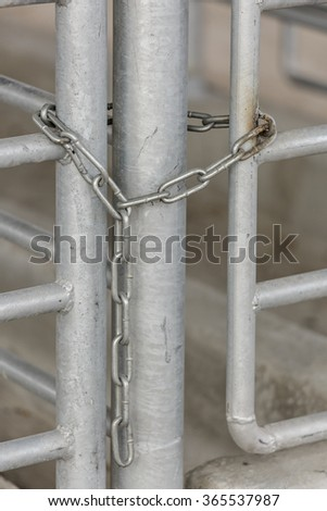Closed chain on steel gates - stock photo