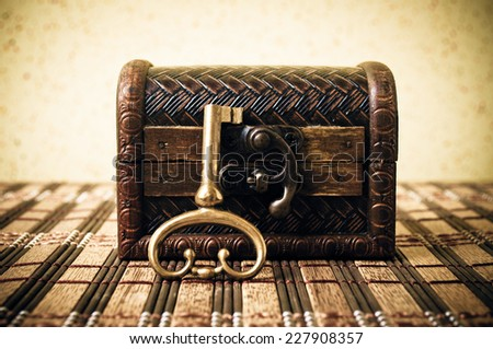 Closed decorative chest with old metal key - stock photo