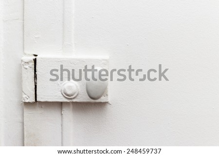 closed door with old vintage white painted lock close-up - stock photo