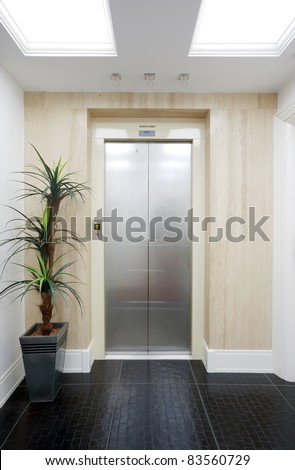 Closed elevator door in a hotel. - stock photo