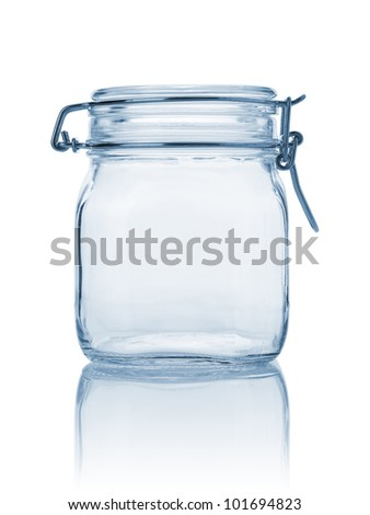 Closed empty glass jar, blue toned and isolated on white - stock photo