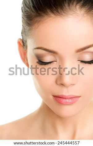 Closed eyes beauty face - Asian chinese woman showing fake eyelashes or eye makeup - stock photo