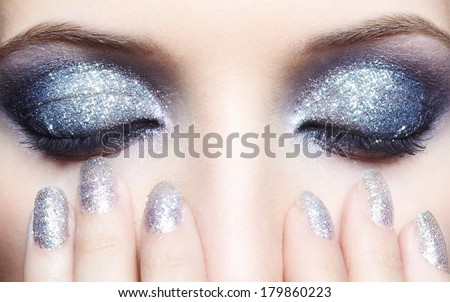 Closed eyes of young woman with vogue shining sparkle makeup - stock photo