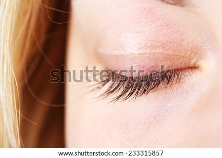 Closed female eye close-up - stock photo
