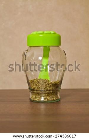 Closed glass jar kitchen storage spices - stock photo