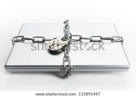 Closed laptop computer with chain wrapped around it and padlocked - stock photo