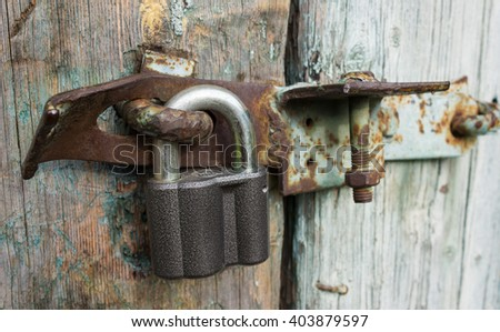 Closed metal lock door on a wooden door - stock photo