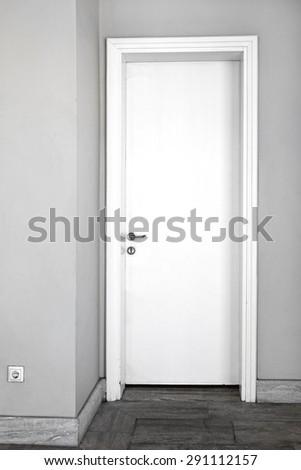 Closed Plane White Door in Home Interior - stock photo