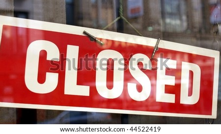 Closed sign in a shop showroom with reflections - (16:9 ratio) - stock photo