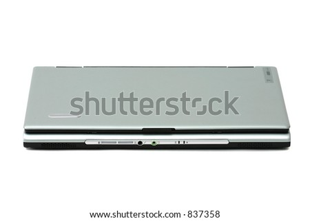 Closed standard silver and black laptop computer with 15 inch screen - stock photo