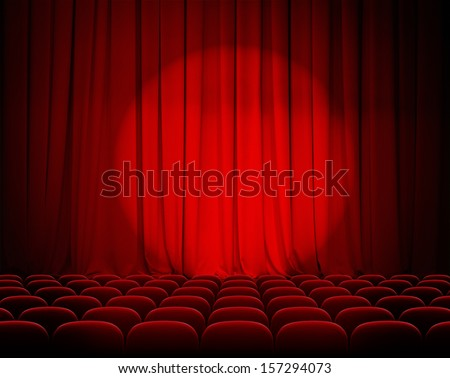 closed theater red curtains with spotlight and seats - stock photo