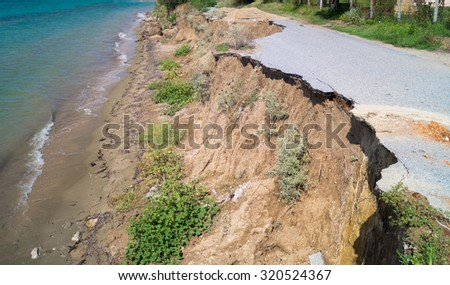 Closed-up cracked asphalt after earthquake - stock photo