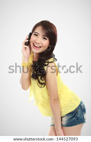 closed up of young girl talking at the handphone - stock photo