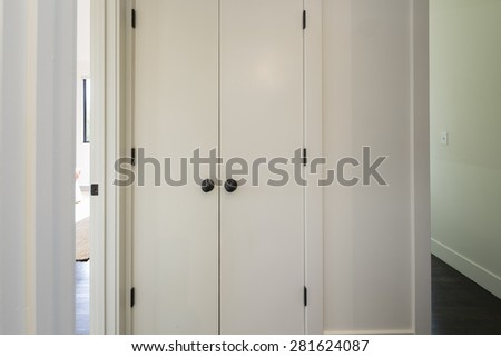 Closed white closet for washer and dryer.  - stock photo