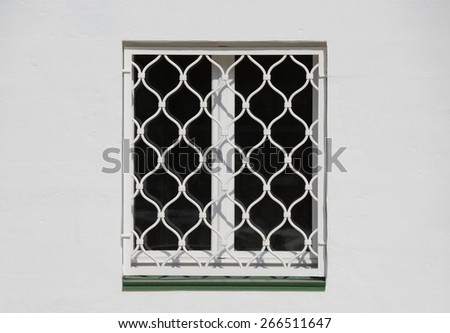 Closed window in the old building on sunny day. - stock photo