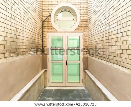 closed windows door with bricked walls - stock photo