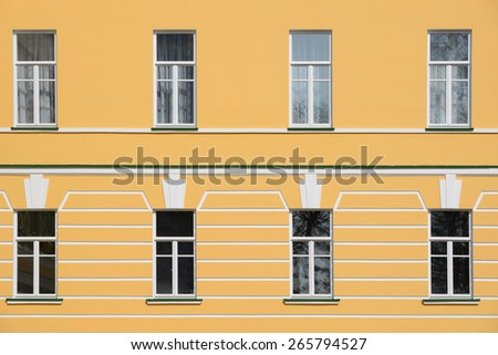 Closed windows in the old building on sunny day. - stock photo