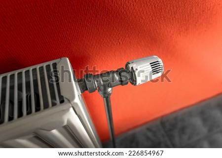 Closep photo of a white radiator valve - stock photo