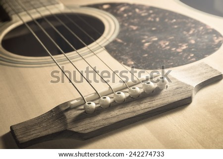 Closeup acoustic guitar,vintage filtered.  - stock photo