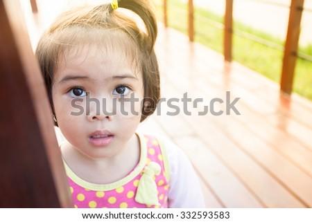 Closeup adorable face little asian girl have beautiful eyes. - stock photo