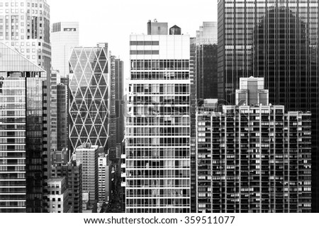 Closeup aerial of skyscrapers in Midtown Manhattan in New York City along Eighth Avenue - stock photo