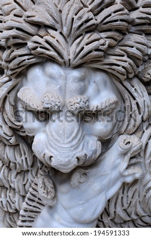 Closeup ancient Roman bas-relief with the image of the lion killing the victim in Vatican Museums  - stock photo