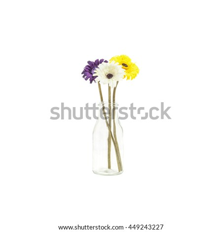 Closeup artificial colorful fabric flower on transparent glass bottle isolated on white background - stock photo