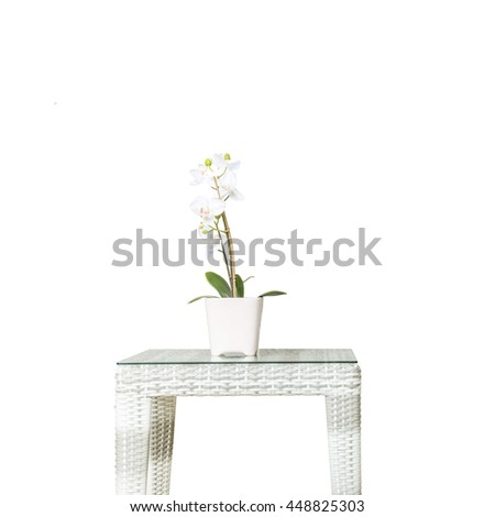 Closeup artificial plant with white orchid flower on pink flower pot on wood weave table isolated on white background , beautiful interior in relaxation concept of house - stock photo