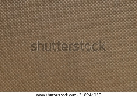 Closeup at front cover of brown note book background - stock photo