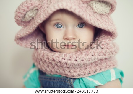 Closeup baby face in snood - stock photo