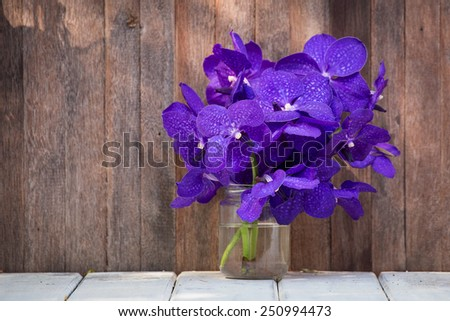 Closeup beautiful bouquet of orchids flower on a wooden background - stock photo