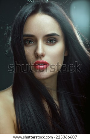 Closeup beauty portrait of a sexy brunette girl with flying hair. Magnificent hair. - stock photo