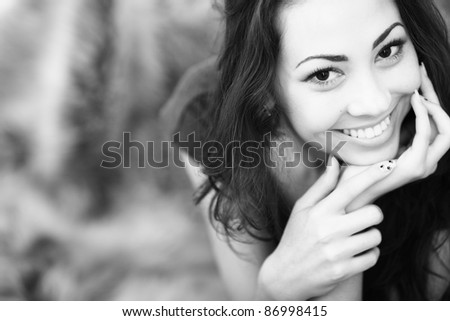 Closeup black and white portrait of a happy young woman smiling - stock photo