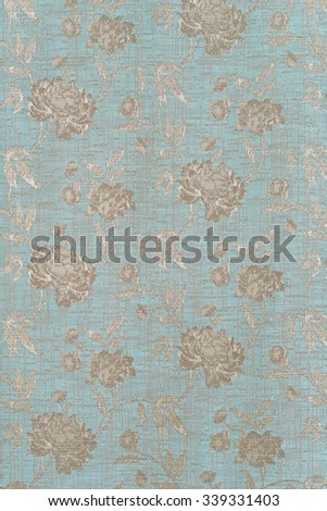closeup blue fabric with silver roses - stock photo