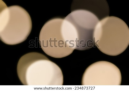 Closeup, blurry, out of focus view of Christmas tree light bulbs. - stock photo