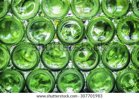 Closeup bottoms of green color bottles background - stock photo