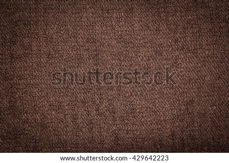 Closeup brown towel texture fabric for background and design with copy space for text or image. Dark edged. - stock photo