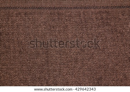 Closeup brown towel texture fabric for background and design with copy space for text or image. - stock photo