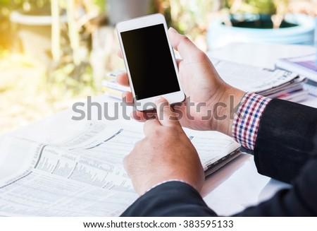 Closeup Business man Using a smartphone. - stock photo